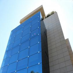 Marble Cladding & Illuminated Structural Glass Facade