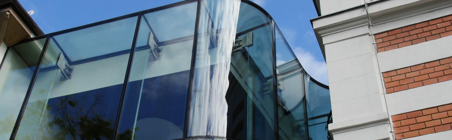 Structural Glass Facade with Glass Fins - Bespoke Frameless System with Oversized Glass